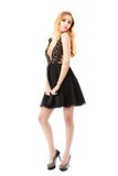 Portrait of the beautiful blonde in black dress. Stock Photo