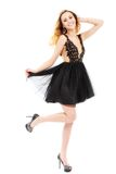 Portrait of the beautiful blonde in black dress. Royalty Free Stock Photo