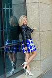 Portrait of a beautiful blonde in blue skirt Stock Image