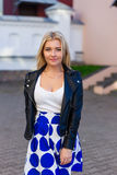 Portrait of a beautiful blonde in blue skirt Royalty Free Stock Photography