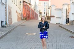 Portrait of a beautiful blonde in blue skirt Royalty Free Stock Photos