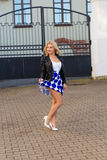 Portrait of a beautiful blonde in blue skirt Royalty Free Stock Images