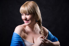 Portrait of beautiful blonde braiding a plait Royalty Free Stock Photography