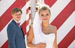 Portrait of beautiful blonde bride posing on roof top Stock Photos