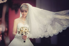 Portrait of a beautiful blonde bride with wedding bouquet Royalty Free Stock Photos