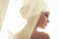 Portrait of beautiful blonde bride. Wedding day. Daylight Royalty Free Stock Photography