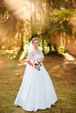 Portrait of a beautiful blonde. The bride in a white dress on a sunny day Royalty Free Stock Photo