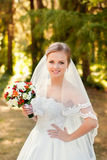 Portrait of a beautiful blonde. The bride in a white dress on a sunny day Stock Images