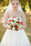 Portrait of a beautiful blonde. The bride in a white dress on a sunny day Royalty Free Stock Images