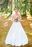 Portrait of a beautiful blonde. The bride in a white dress on a sunny day Stock Photo