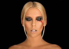 Portrait of a beautiful blonde with creative make-up on Stock Photography