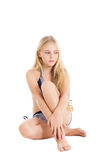 Portrait of a beautiful blonde European girl wearing swimming suit. Studio shot, isolated on white background stock images
