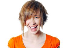 Portrait of a beautiful blonde female laughing. Isolated over a white background Stock Photo