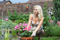 Portrait of a beautiful blonde with flowers Royalty Free Stock Photos