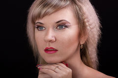 Portrait of a beautiful blonde girl. With art make-up in studio Stock Image
