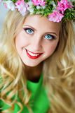 Portrait of a beautiful blonde girl with blue eyes with a floral Stock Photography