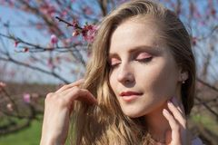 Portrait of a beautiful blonde girl with eyes closed. 1 royalty free stock image