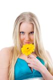 Portrait of a beautiful blonde girl with flower. Royalty Free Stock Images