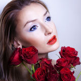 Portrait of beautiful blonde girl with flowers. Stock Images