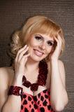 Portrait of beautiful blonde girl in leopard dress Royalty Free Stock Image
