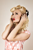 Portrait of beautiful blonde girl listening to music Royalty Free Stock Photo