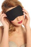Portrait of a beautiful blonde girl with a mask for sleeping  li Royalty Free Stock Image