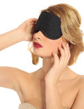 Portrait of a beautiful blonde girl with a mask for sleeping  li Stock Images