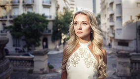 Portrait of beautiful blonde girl in the old city Stock Photo