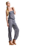 Portrait of the beautiful blonde girl in overalls Royalty Free Stock Photography