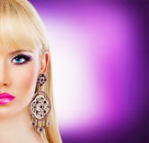 Portrait of beautiful blonde girl with purple makeup Stock Photos