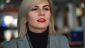 Portrait of a beautiful blonde girl with red lips. Slow motion stock video