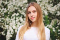 Beautiful blonde girl on the street. Portrait of beautiful blonde girl on the street royalty free stock image