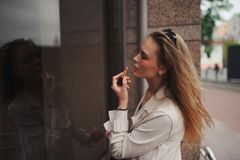 Beautiful blonde girl in the street. Portrait of beautiful blonde girl in the street royalty free stock photo
