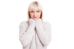 Portrait of beautiful blonde girl wearing sweater Stock Image