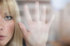 Portrait of beautiful blonde through the glass Royalty Free Stock Photo