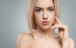 Portrait of  beautiful blonde on a gray background Stock Image
