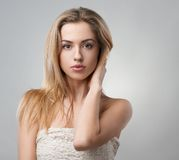 Portrait of  beautiful blonde on a gray background Royalty Free Stock Image