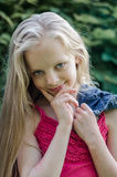 Portrait of a beautiful blonde little girl with long hair. Stock Photos