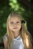 Portrait of a beautiful blonde little girl three years Stock Photos
