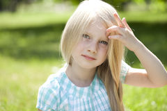 Portrait of a beautiful blonde little girl three years Stock Images