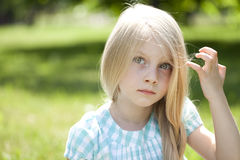 Portrait of a beautiful blonde little girl three years Royalty Free Stock Photo