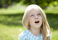 Portrait of a beautiful blonde little girl three years Stock Image