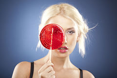 Portrait of a beautiful blonde with a lollipop. Stock Photos