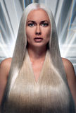 Portrait of a beautiful blonde with futuristic hair. Portrait of a beautiful blonde with a long futuristic hair Stock Image