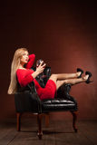 Portrait of beautiful blonde lying in armchair Stock Images