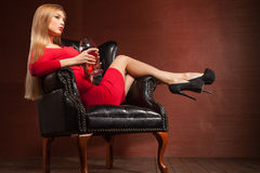 Portrait of beautiful blonde lying in armchair Stock Photography