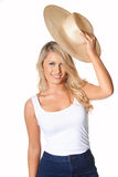 Portrait of beautiful blonde model lifting straw hat, isolated o Royalty Free Stock Image