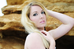 Portrait of the beautiful blonde near clay captive Royalty Free Stock Photos
