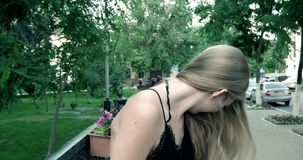 Portrait of a beautiful blonde outdoors  having stock video footage