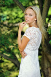 Portrait of a beautiful blonde in a park Royalty Free Stock Image